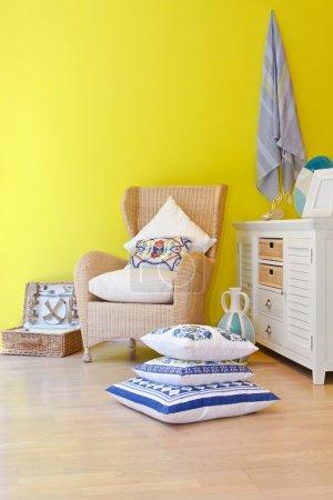 Rattan armchair with pillows in mediterranean styl...