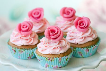 Photo for Cupcakes decorated with sugar roses - Royalty Free Image