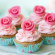 Cupcakes decorated with sugar roses...