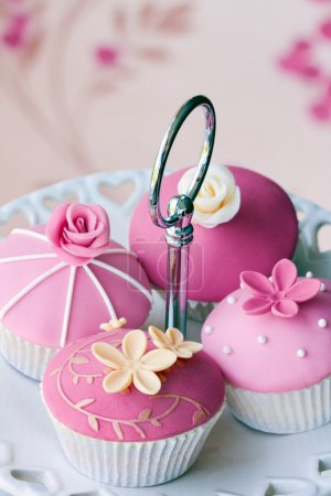 Gourmet cupcakes decorated with fondant and sugar ...