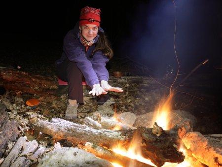 Girl near campfire