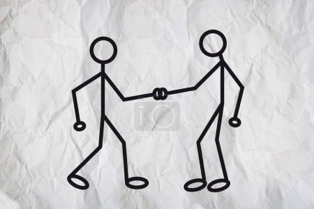 Photo pour Illustration de deux figures humanoïdes se serrant la main et se saluant sur un fond de texture de papier blanc . - image libre de droit