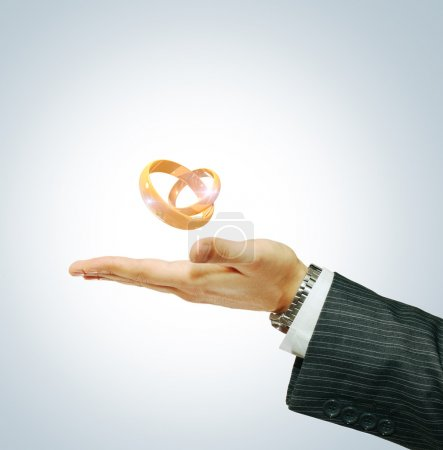Two wedding ring on a businessman's hand