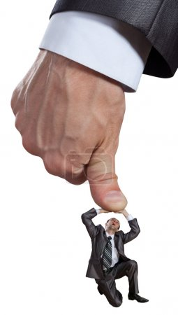 Big hand pushing businessman