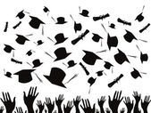 Students graduating and tossing caps