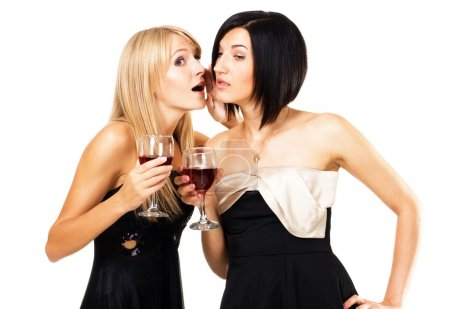 Photo for Two young ladies on the party are gossiping - Royalty Free Image