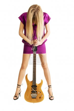 Hot girl playing an electric guitar