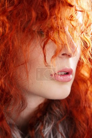 Photo for Closeup portrait of a beautiful red-haired woman - Royalty Free Image