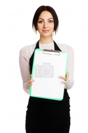 Foto de Beautiful young woman holding a blank sheet, white background - Imagen libre de derechos