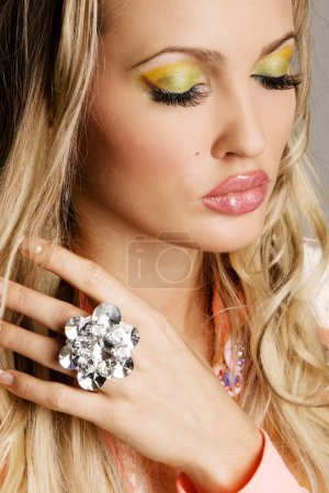 Fashionable young woman with vibrant makeup