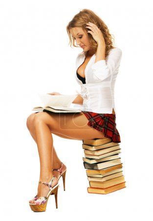 Sexy student girl with a stack of books