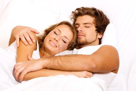 Young beautiful couple sleeping