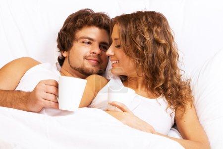 Young beautiful couple enjoying morning coffee