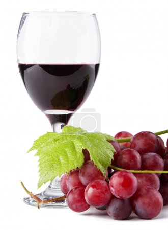 Glass of red wine, with grapes on foreground