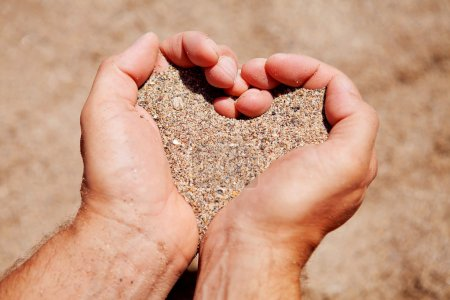 Hands filled with sand