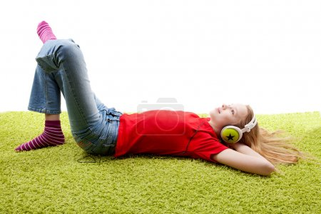 Photo for Girl is listening to music with headphones on over white background - Royalty Free Image