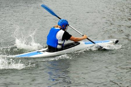 Man racing in kayak