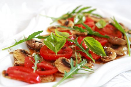 Photo for Champignon Carpaccio with marinated tomato and rucola salad - Royalty Free Image