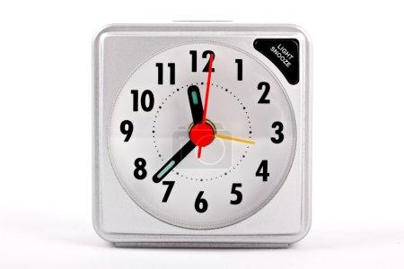 Travel alarm clock on white background