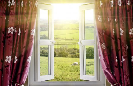 Open window with countryside view and fresh sunlight streaming in