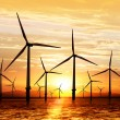 Silhouette of wind turbine generating electricity ...