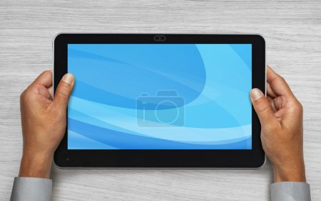 Hands holding touchpad