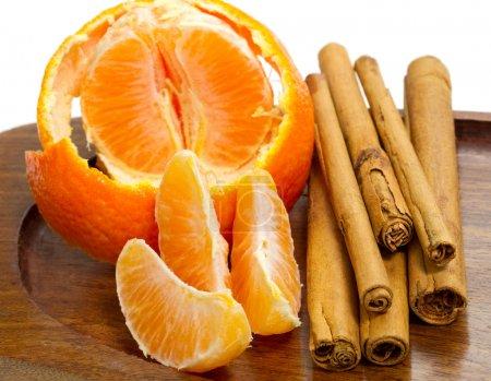 Orange with cinnamon sticks