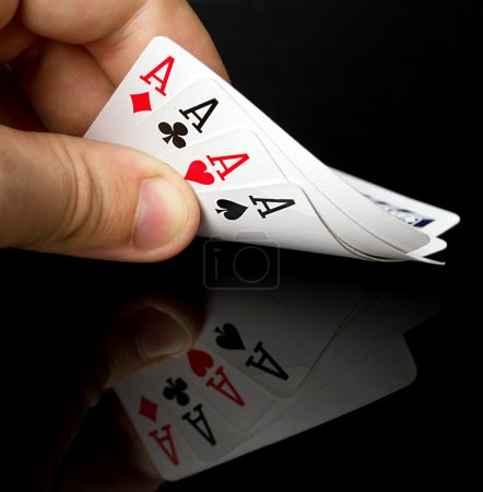 Photo for Four aces in hand with reflection - Royalty Free Image