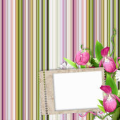 Paper frame on striped background in pink, green and white