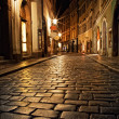 Mysterious narrow alley with lanterns in Prague at...