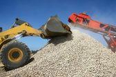 Kamenné hromady a stroje