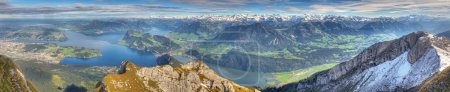 Photo for Long panorama of whole lake Lucerne framed by high alpine mountains on a summer day, Switzerland - Royalty Free Image