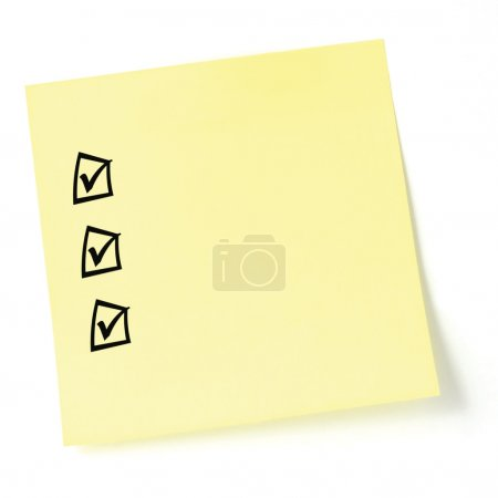 Yellow sticker checklist, black tick marks and checkboxes, isola