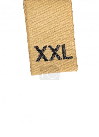 Macro of XXL size clothing label on white, isolated