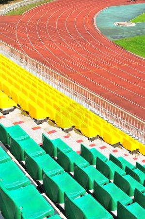 Photo pour Colorful rows of plastic chairs at the stadium - image libre de droit