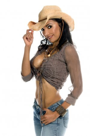 Super sexy rodeo cowgirl in torn jeans, boots and cowboyhat