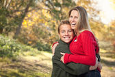 Playful Mother and Son Pose for a Portrait Outdoors