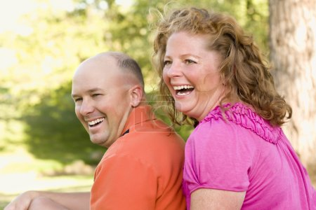 Photo for Happy Attractive Couple Laughing in the Park. - Royalty Free Image