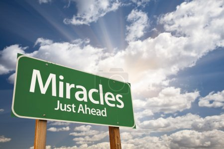 Photo for Miracles Green Road Sign Against Clouds and Sunburst. - Royalty Free Image