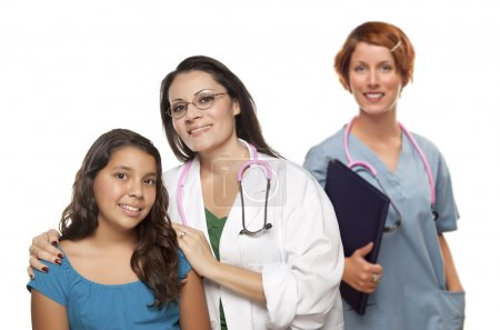 Hispanic Female Doctor with Child Patient and Colleague