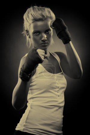 Attractive blonde fighter girl