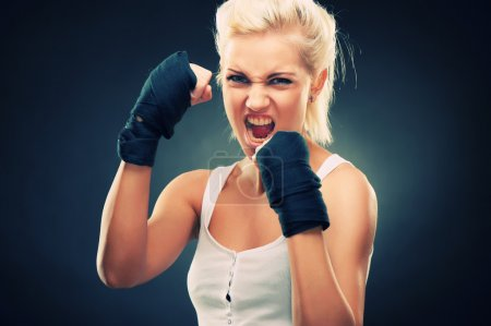 Photo for Attractive blonde fighter girl, studio shot, cross processed - Royalty Free Image