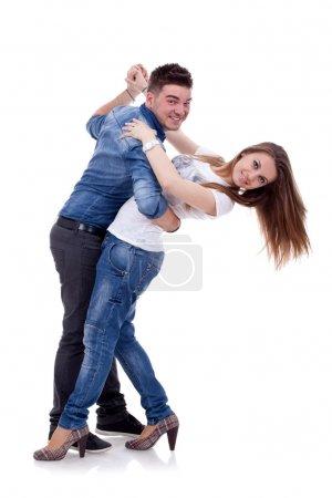 Photo pour Photo d'un jeune couple dancing sur fond blanc - image libre de droit