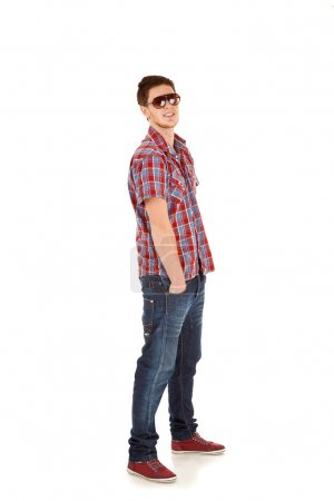 Casual young man standing with hands in pockets
