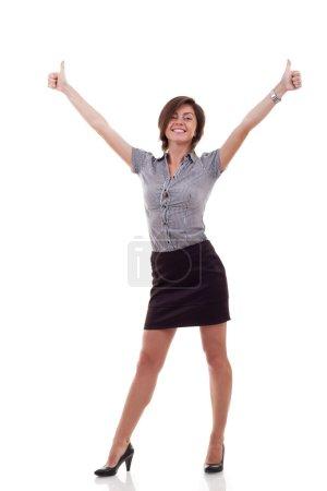 Photo pour Heureuse femme d'affaires excitée d'abandonner les pouces. Isolé sur fond blanc - image libre de droit