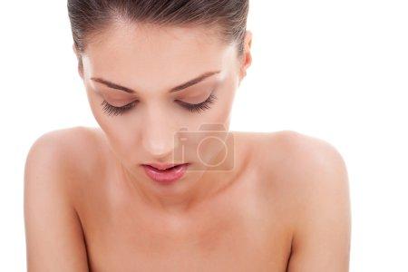 Woman looking down, pensive