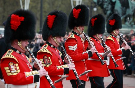 Queens guards marching and playing music