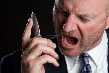 Photo for Angry man screaming on phone - Royalty Free Image