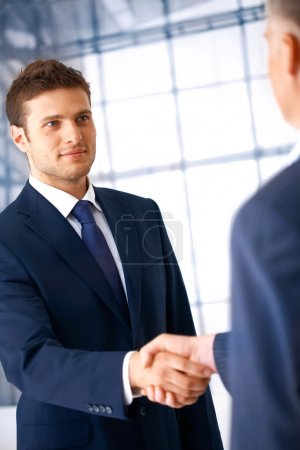 Photo for Business shaking hands, coming to an agreement in the office. - Royalty Free Image