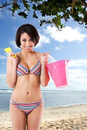 Black bikini woman at the beach